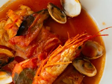 Monkfish medallions in sauce with clams and prawns