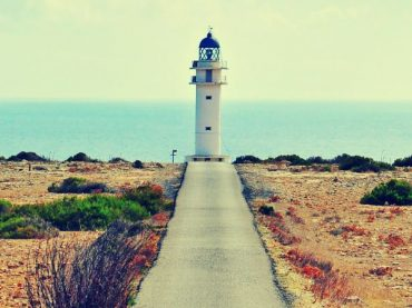 The lighthouse of cape Barbaria, shining at the edge of the Balearic Islands