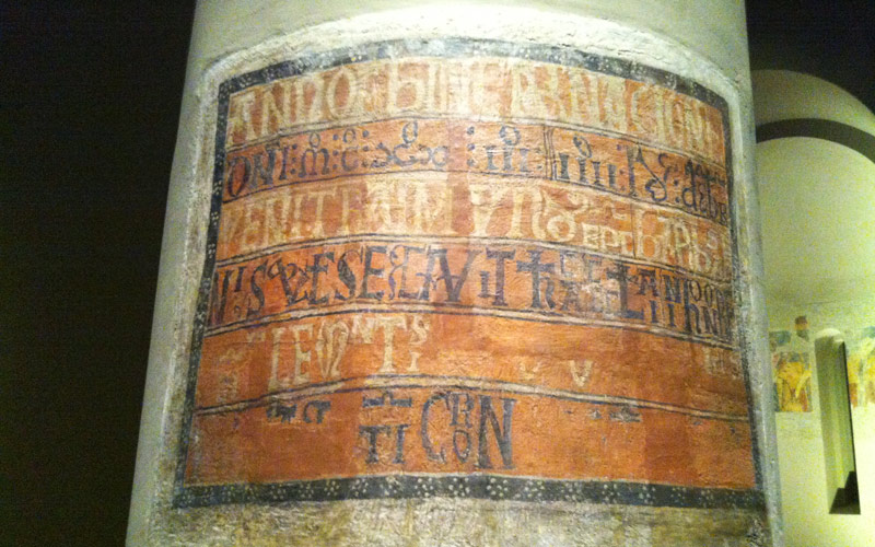 Inscription found on a column of the church showing the date of consecration. Photo: Kippelboy